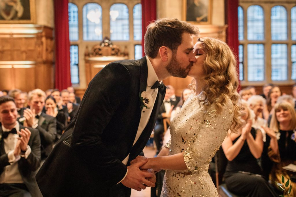 bride and groom first kiss at Oxford Town Hall wedding taken by Becky Harley Photography
