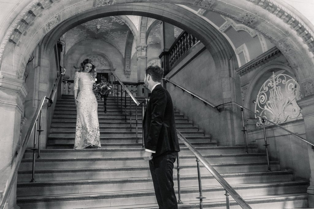 bride and groom on staircase at Oxford Town Hall wedding taken by Becky Harley Photography