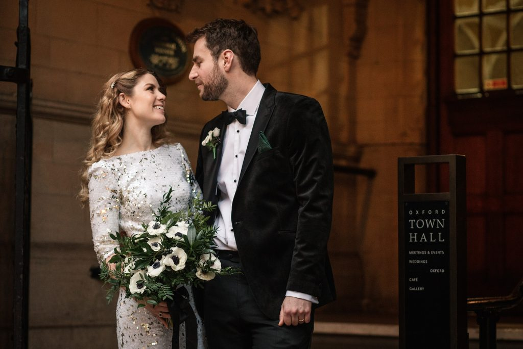 bride and groom on steps of town hall at Oxford Town Hall wedding taken by Becky Harley Photography