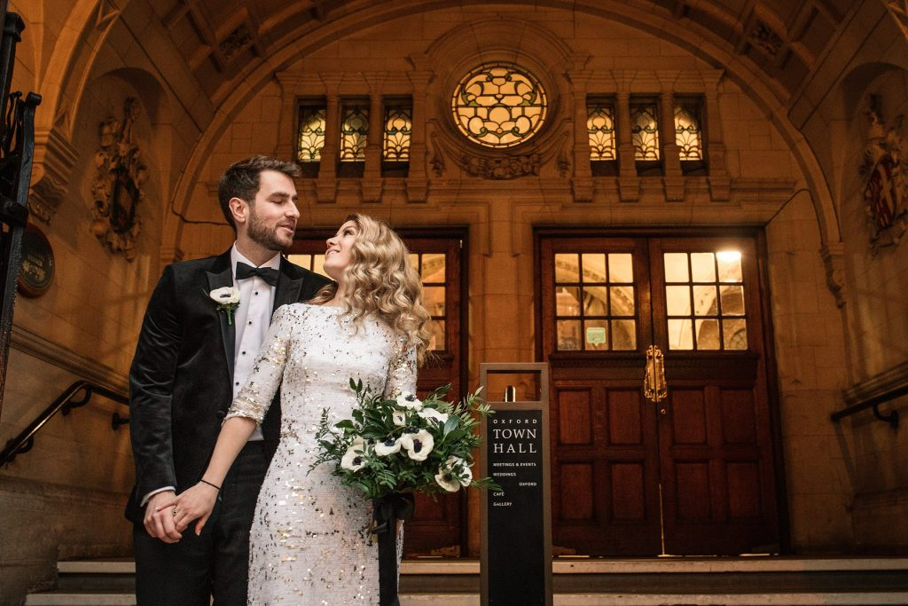 bride and groom on steps of oxford town hall at Oxford Town Hall wedding taken by Becky Harley Photography