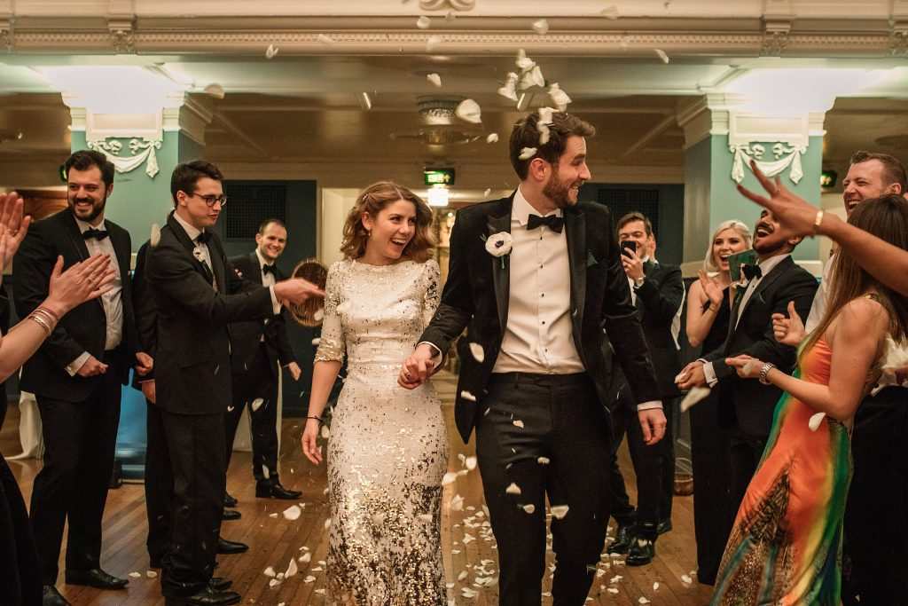 bride and groom with confetti at Oxford Town Hall wedding taken by Becky Harley Photography