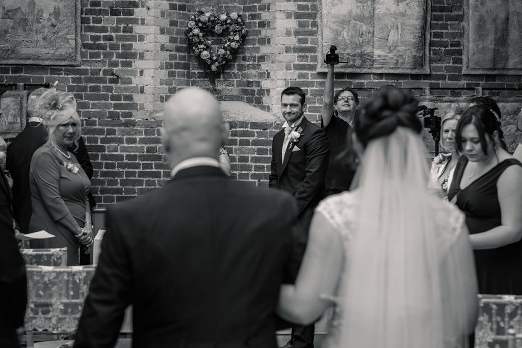 Groom first look at Bride at Offley Place taken by Becky Harley Photography