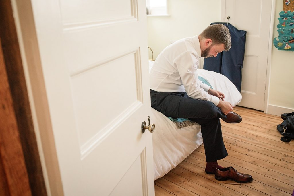 Groom getting ready taken by Becky Harley Photography