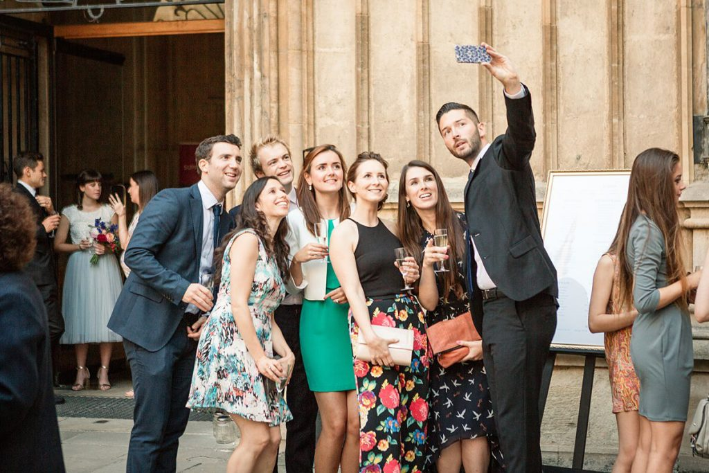 guests take a selfie at Oxford wedding taken by Becky Harley Photography