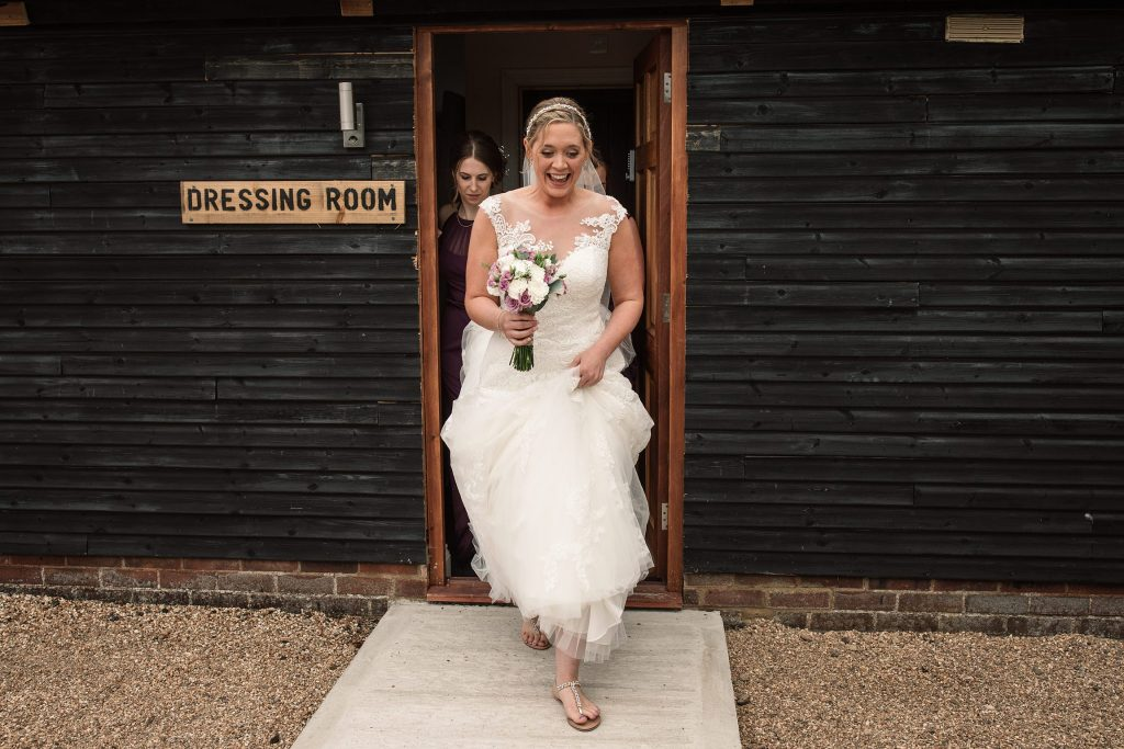 Bride walking to ceremony at relaxed, rustic Milling Barn Wedding, taken by Becky Harley Photography