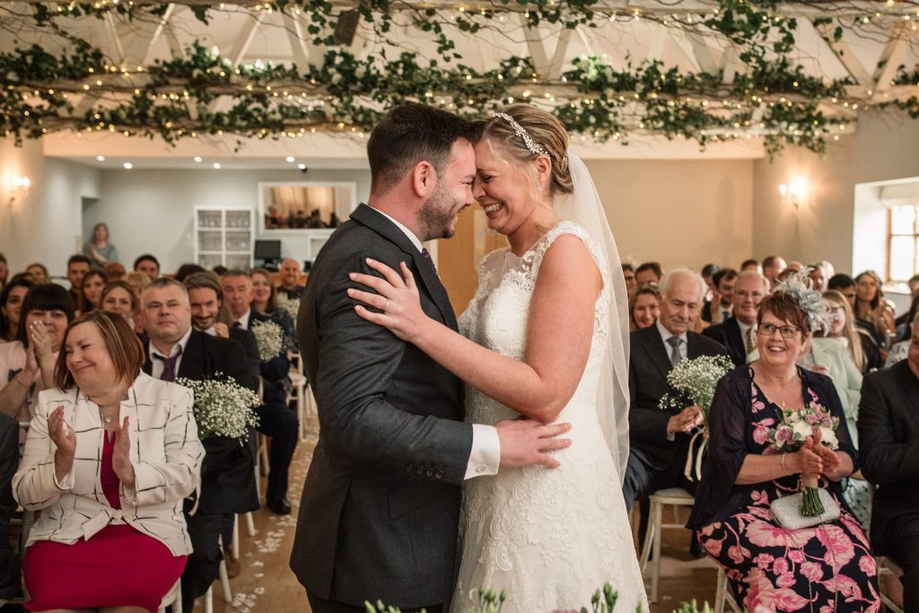 Bride and Groom first kiss at relaxed, rustic Milling Barn Wedding, taken by Becky Harley Photography