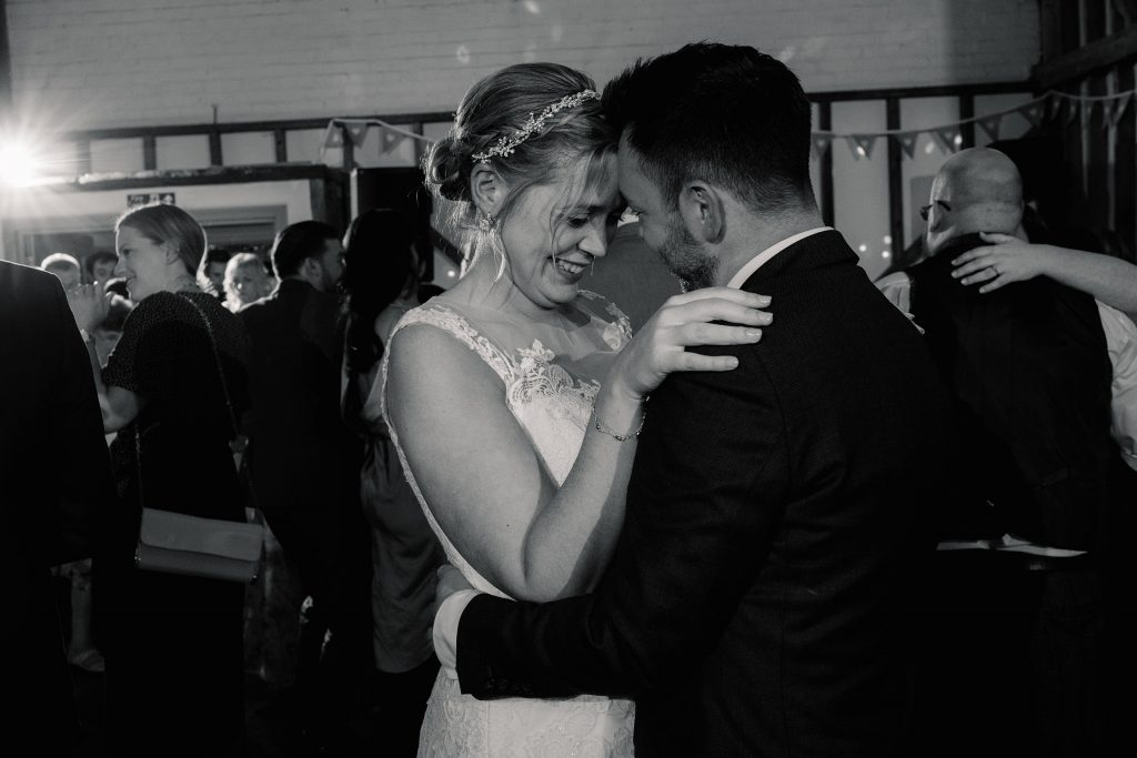 Bride and groom first dance at relaxed, rustic Milling Barn Wedding, taken by Becky Harley Photography