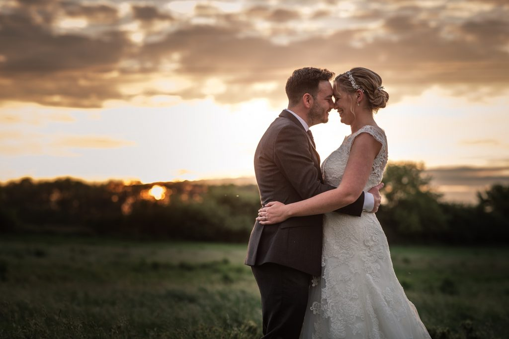Bride and Groom with sunset at relaxed, rustic Milling Barn Wedding, taken by Becky Harley Photography