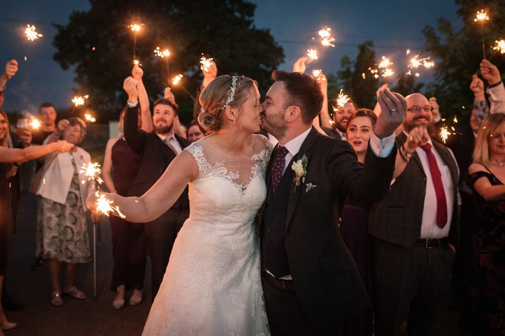 Bride and Groom with sparklers at relaxed, rustic Milling Barn Wedding, taken by Becky Harley Photography
