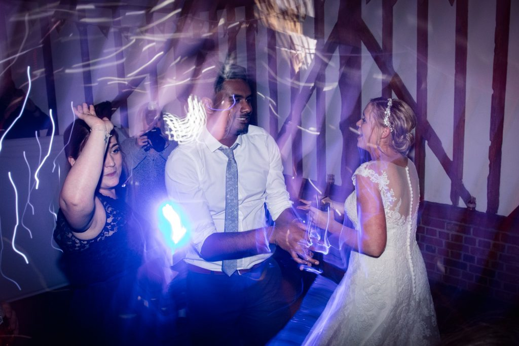 Bride and guests dancing at relaxed, rustic Milling Barn Wedding, taken by Becky Harley Photography