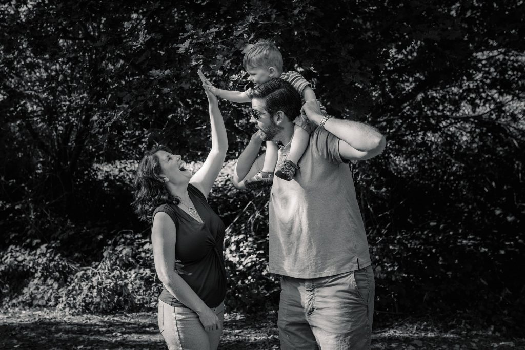 family high fiving at St Albans Family Photo Shoot taken by Becky Harley Photography