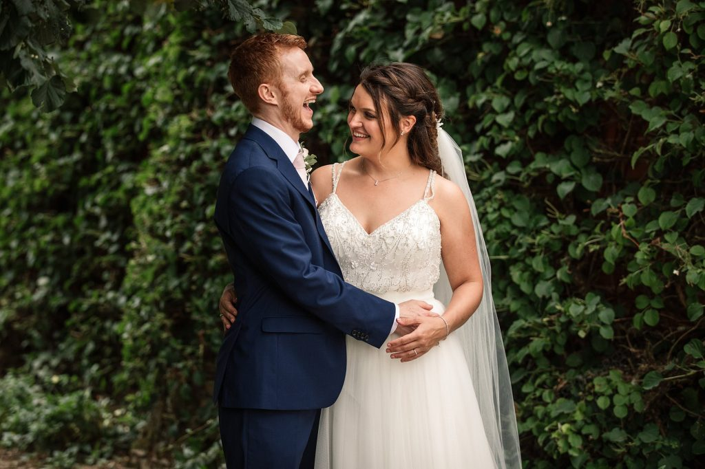 Bride and Groom laughing at Granary Estates Wedding taken by Becky Harley Photography