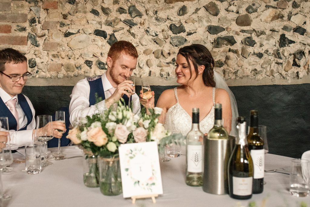 Bride and Groom clinking glasses at Granary Estates Wedding taken by Becky Harley Photography