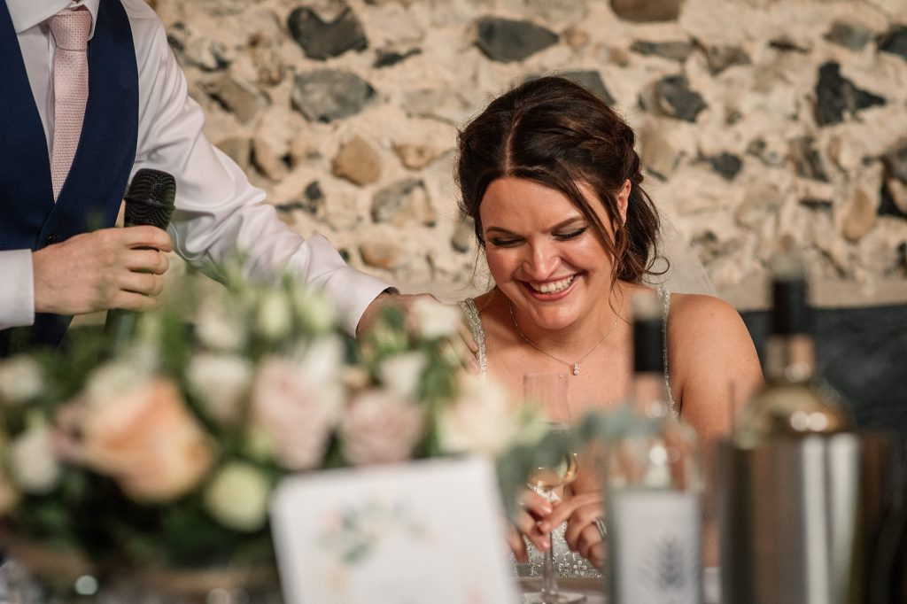 Bride laughing at Granary Estates Wedding taken by Becky Harley Photography
