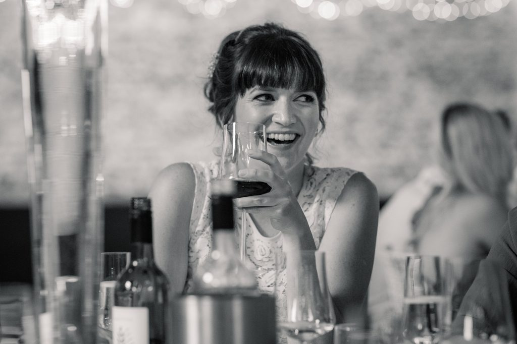 Bridesmaid laughing at Granary Estates Wedding taken by Becky Harley Photography
