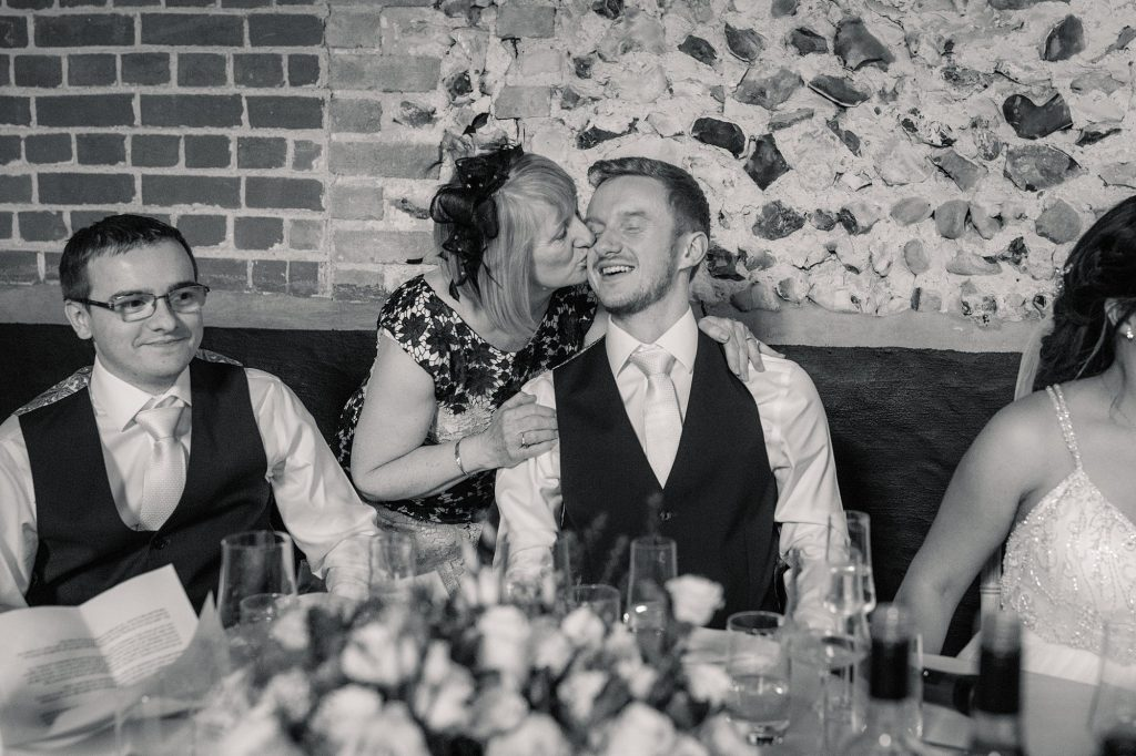 Mother of the Groom kissing groom at Granary Estates Wedding taken by Becky Harley Photography
