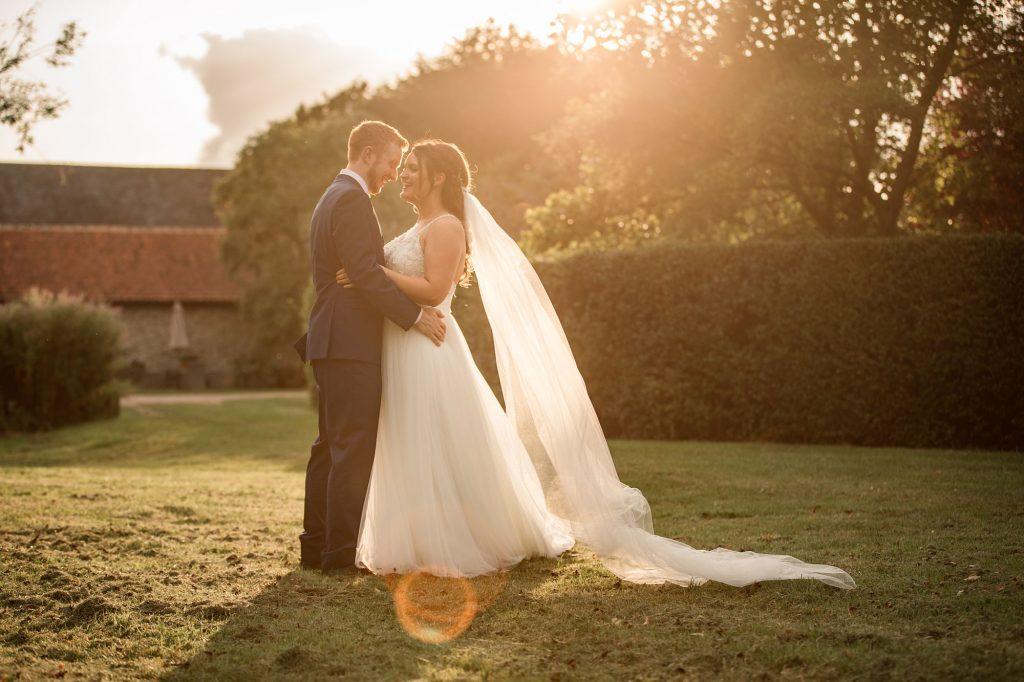 Bride and Groom in evening sun at Granary Estates Wedding taken by Becky Harley Photography