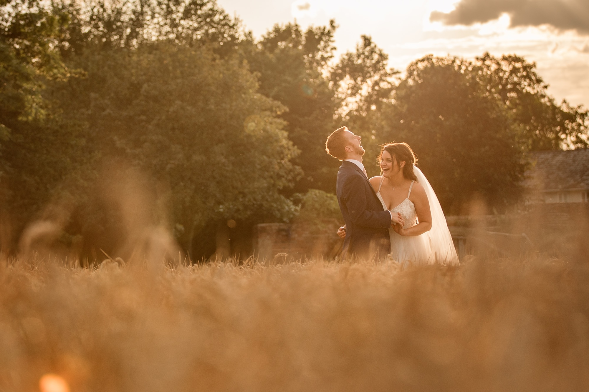 Bride and Groom in evening sun in confield at Granary Estates Wedding taken by Becky Harley Photography
