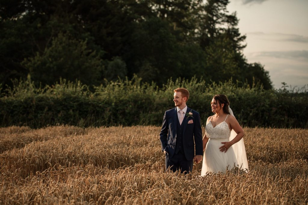Bride and groom in cornfield at Granary Estates Wedding taken by Becky Harley Photography