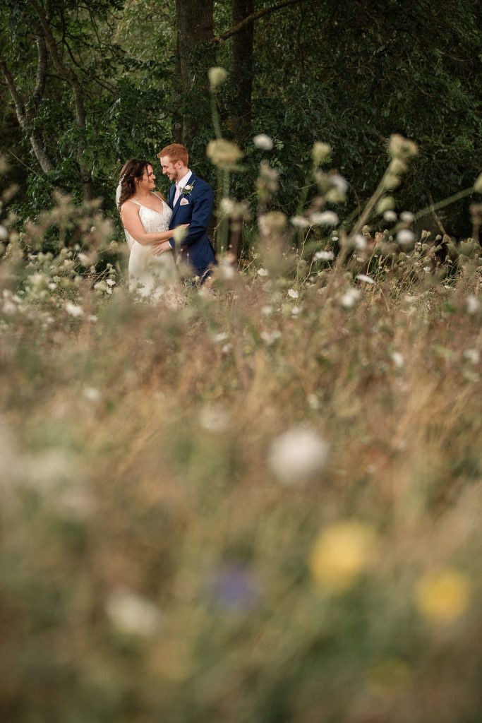 Bride and Groom and wildflowers