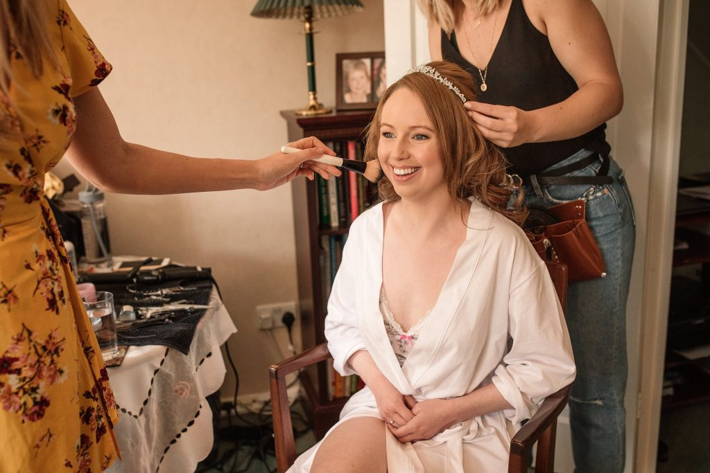 Bride getting ready for springtime coltsfoot wedding taken by Becky Harley Photography