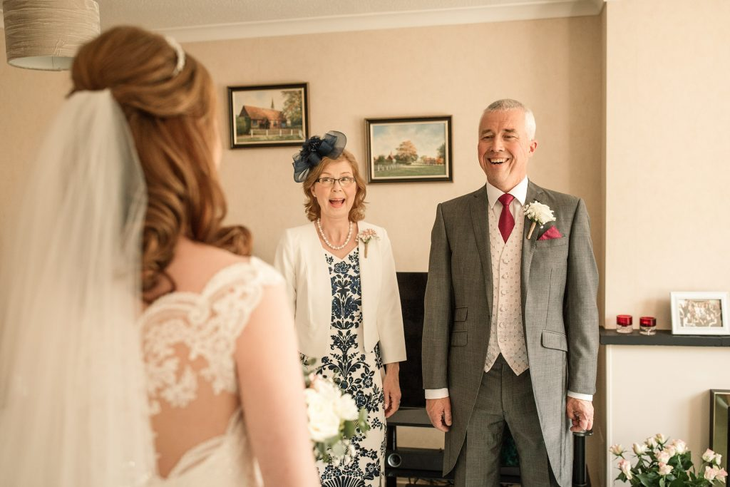 Brides parents seeing her in dress at springtime coltsfoot wedding taken by Becky Harley Photography