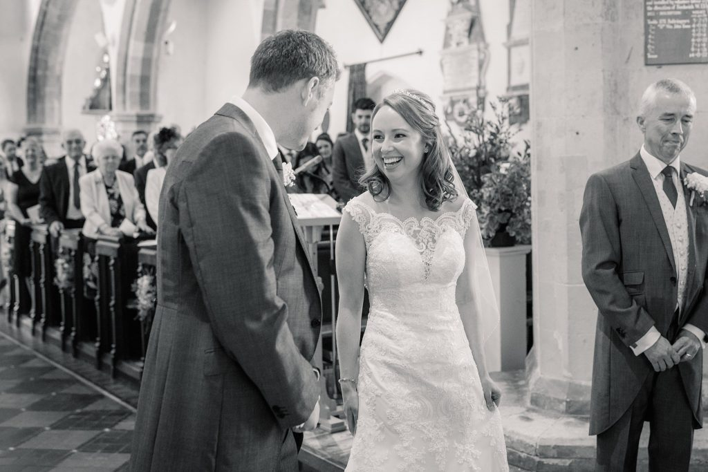 Bride and groom in church at springtime coltsfoot wedding taken by Becky Harley Photography