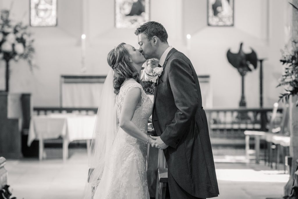 Bride and Groom's first kiss at springtime coltsfoot wedding taken by Becky Harley Photography