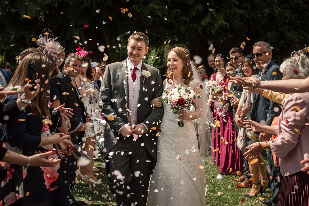 Bride and Groom with confetti at springtime coltsfoot wedding taken by Becky Harley Photography