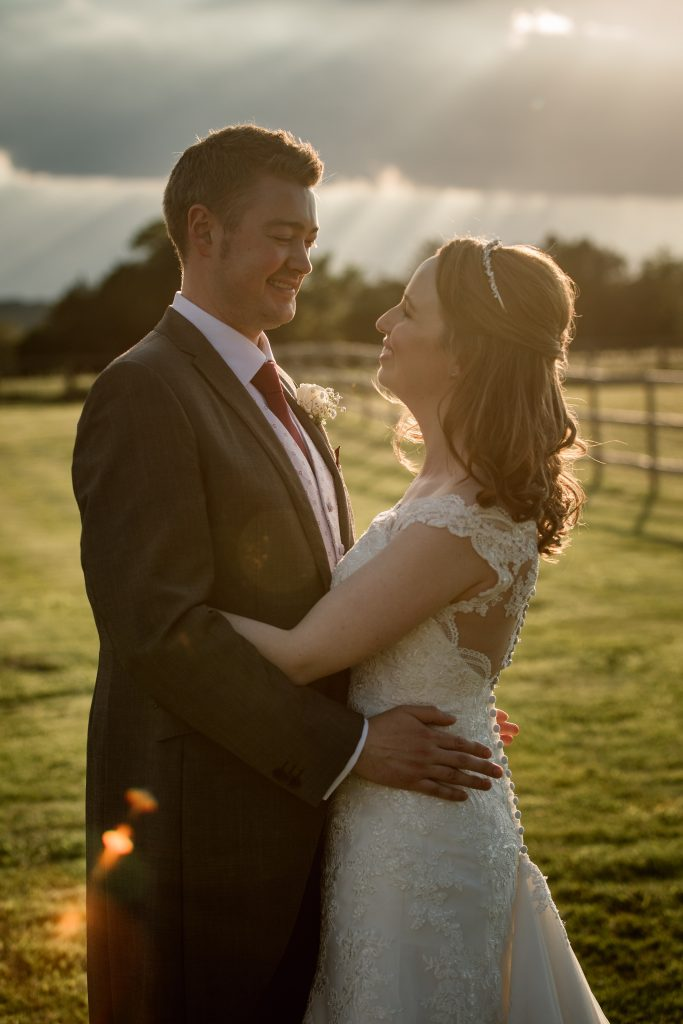 Couples portrait in evening sun at springtime coltsfoot wedding taken by Becky Harley Photography