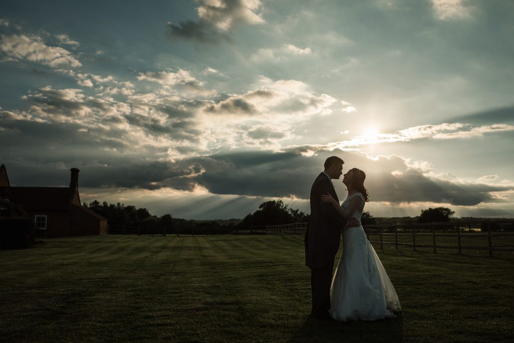 Couple silhouette with sky at springtime coltsfoot wedding taken by Becky Harley Photography