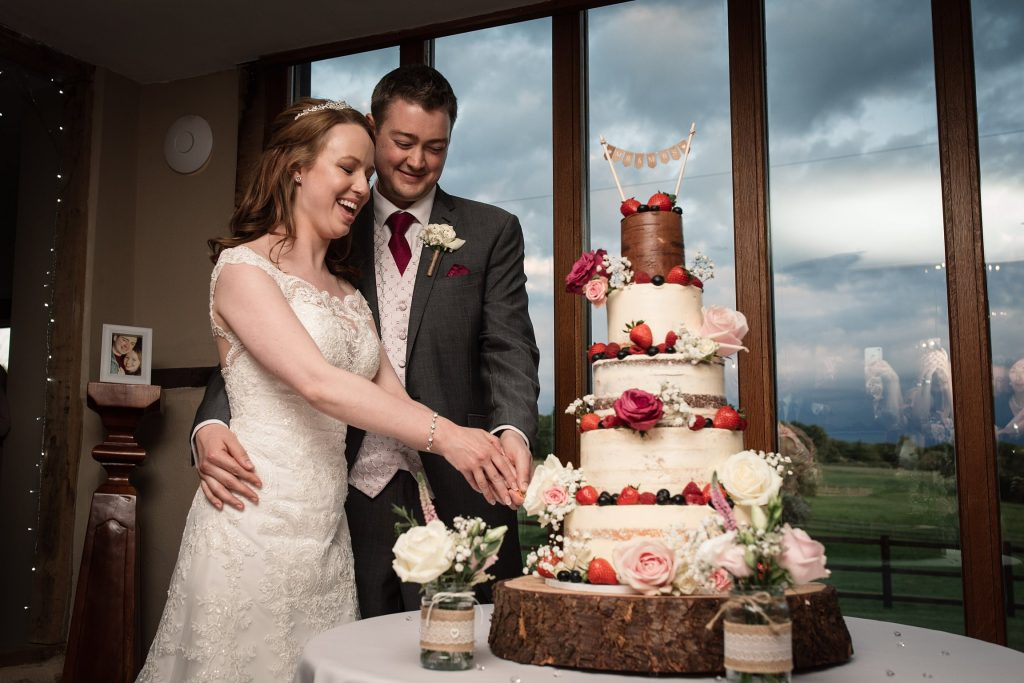 Bride and groom cutting cake at springtime coltsfoot wedding taken by Becky Harley Photography