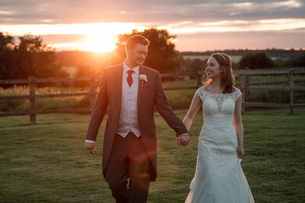 Bride and groom with sunset at springtime coltsfoot wedding taken by Becky Harley Photography
