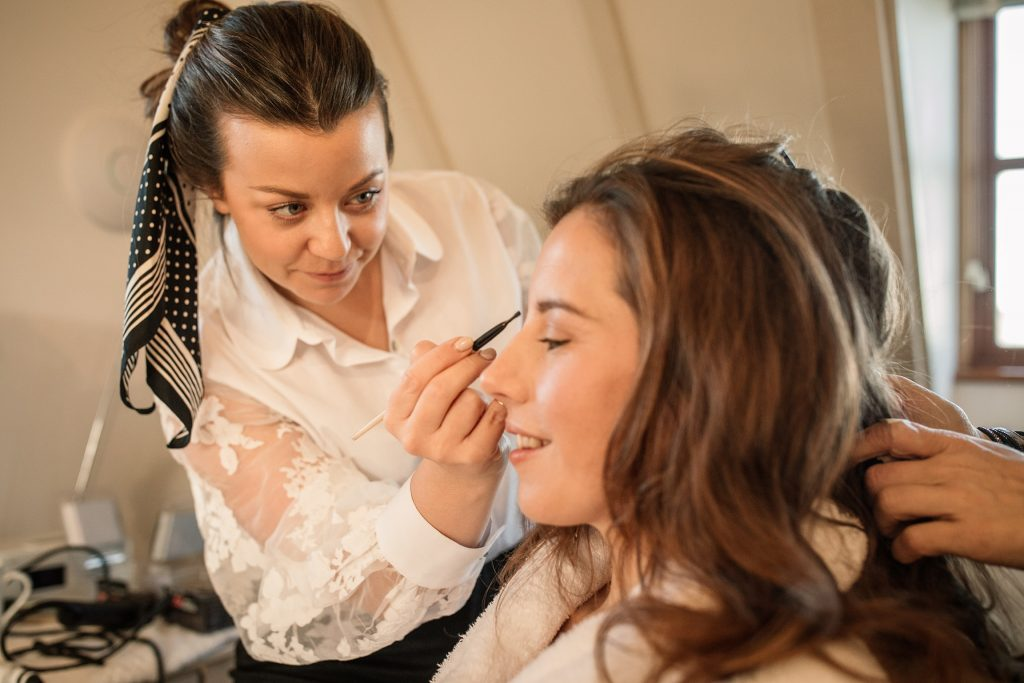 Michelle Nash Make Up doing bridal make up at winter wedding inspiration shoot taken by Becky Harley Photography