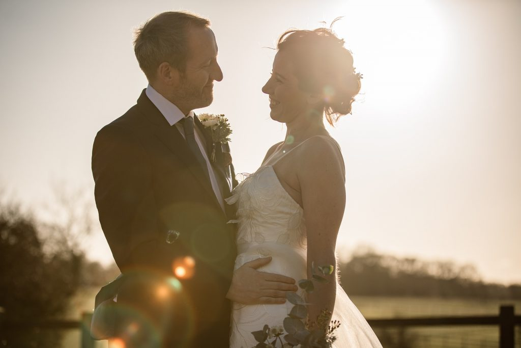 Bride and Groom with sun flare at winter wedding inspiration shoot taken by Becky Harley Photography