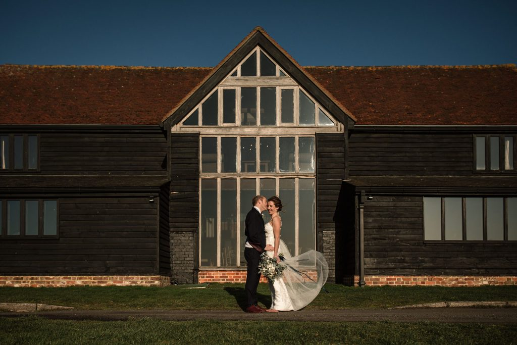 Bride and Groom outside Coltsfoot Country Retreat at winter wedding inspiration shoot taken by Becky Harley Photography