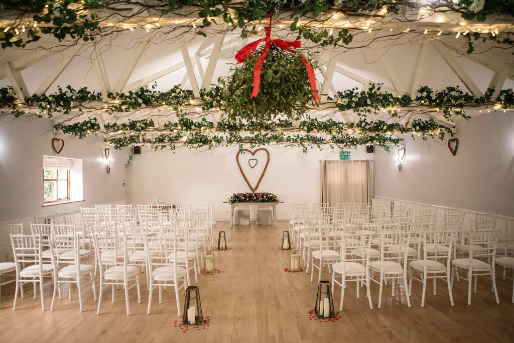 Interior of the Dairy Barn at Milling Barn set up for wedding ceremony, one of the best barn wedding venues in Hertfordshire. Taken by Becky Harley Photography