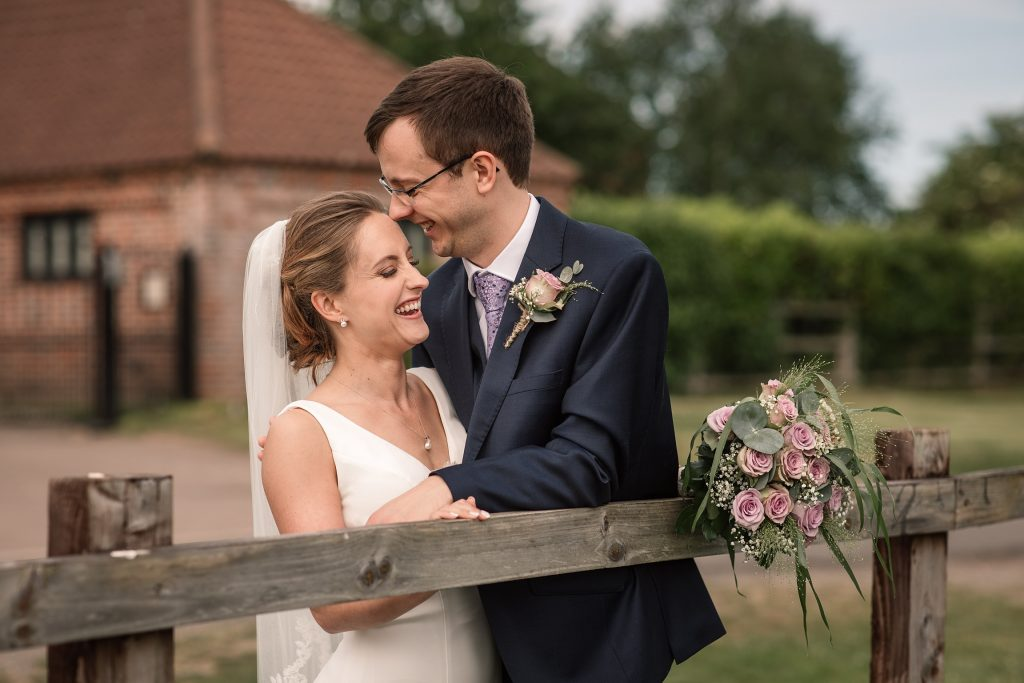 Bride and groom at Coltsfoot Country Retreat, one of the best barn wedding venues in Hertfordshire. Taken by Becky Harley Photography