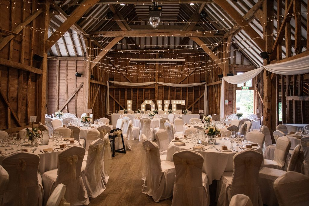 Interior of the Tythe Barn at Tewin Bury Farm Hotel, one of the best barn wedding venues in Hertfordshire. Taken by Becky Harley Photography