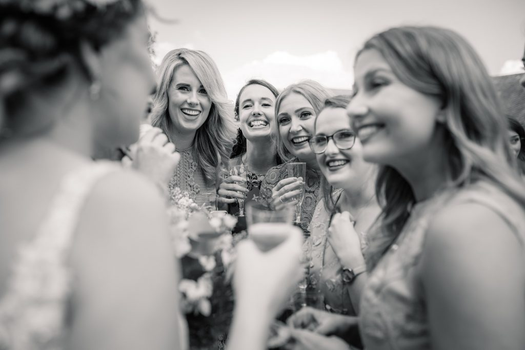 can i plan a wedding in six months? Bride and wedding guests taken by Becky Harley Photography