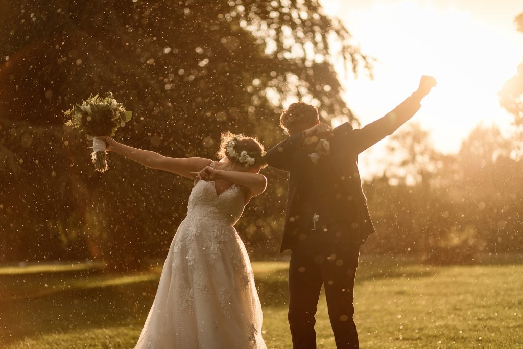 can i plan a wedding in six months? Bride and groom in the rain taken by Becky Harley Photography