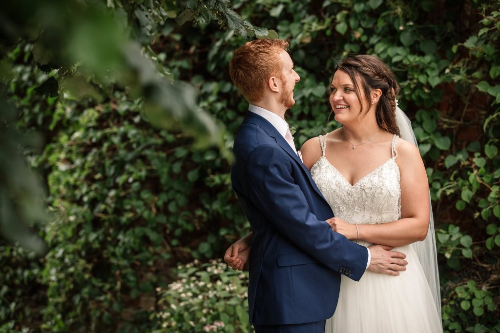 can i plan a wedding in six months? Bride and Groom cuddling taken by Becky Harley Photography