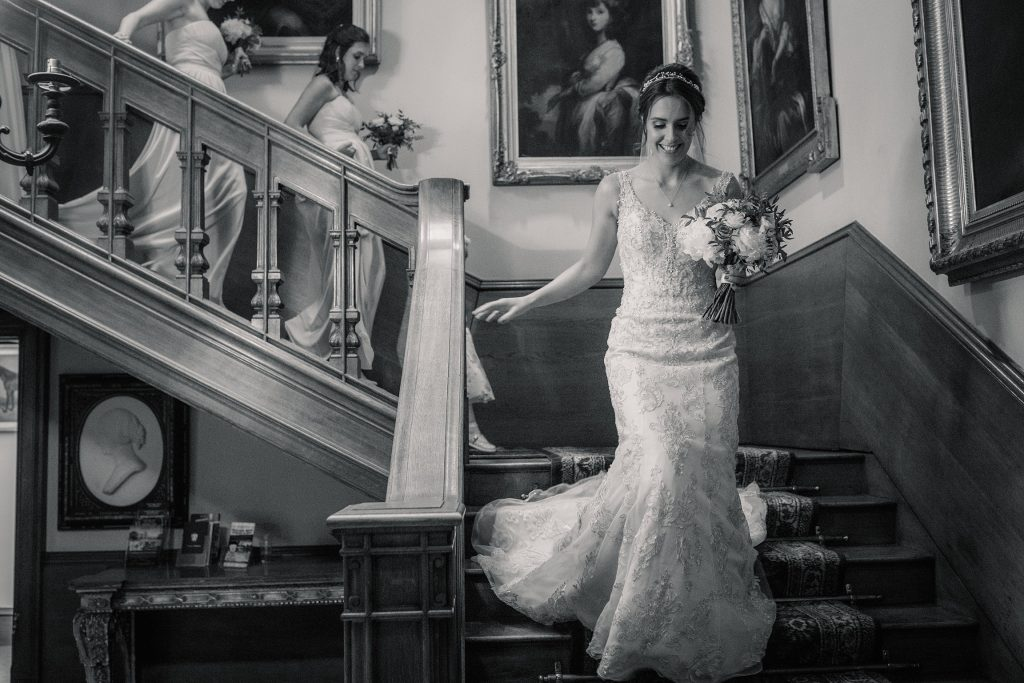 Bride walking down stairs to ceremony at Shuttleworth Collection Wedding, taken by Becky Harley Photography