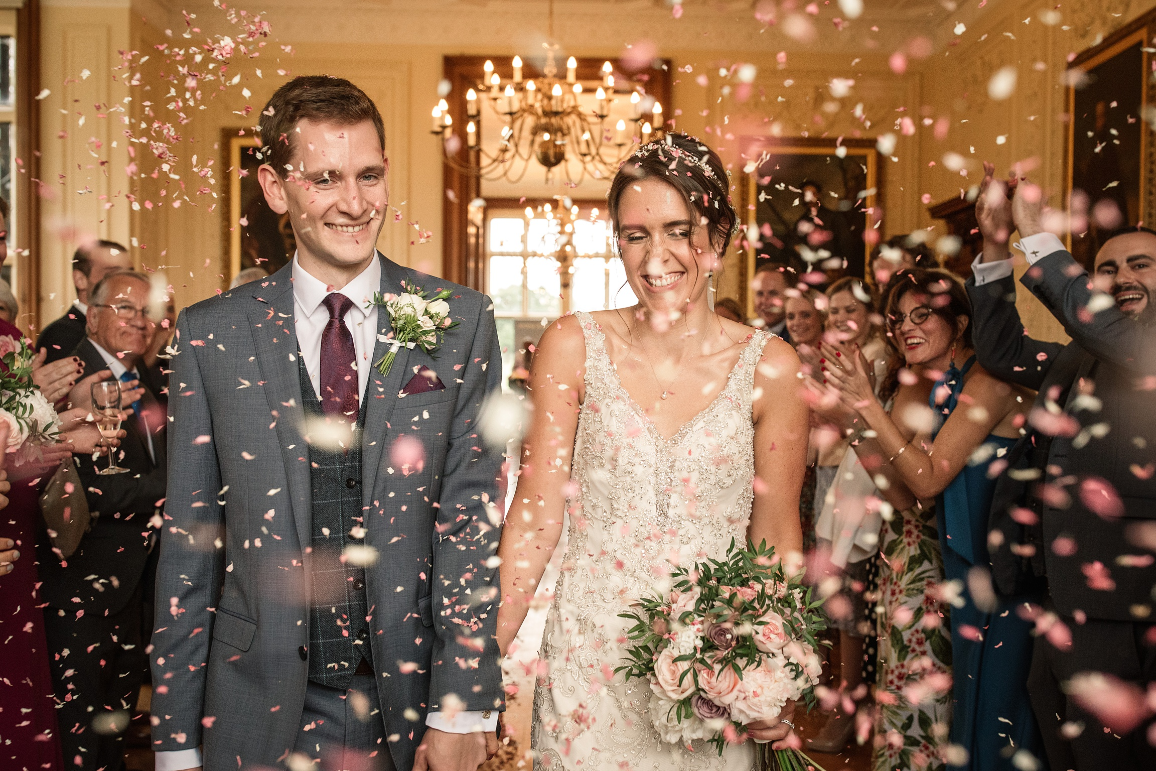 Bride and groom indoor confetti throw at Shuttleworth Collection Wedding, taken by Becky Harley Photography