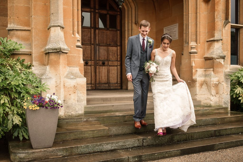 bride and groom walking outside at Shuttleworth Collection Wedding, taken by Becky Harley Photography