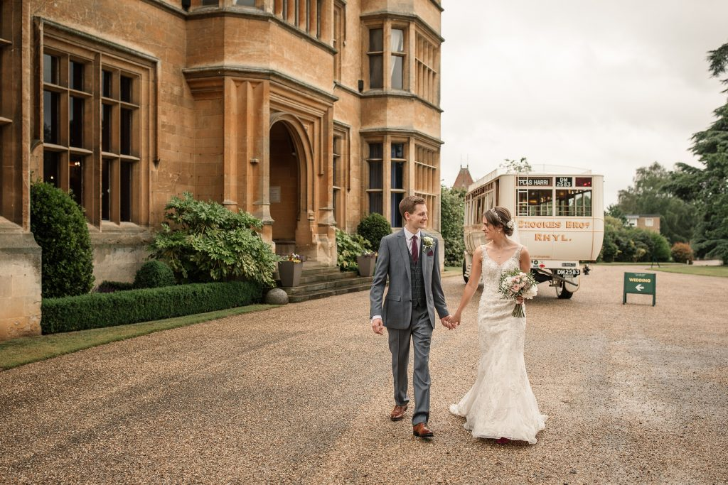 Bride and groom walking outisde House at Shuttleworth Collection Wedding, taken by Becky Harley Photography