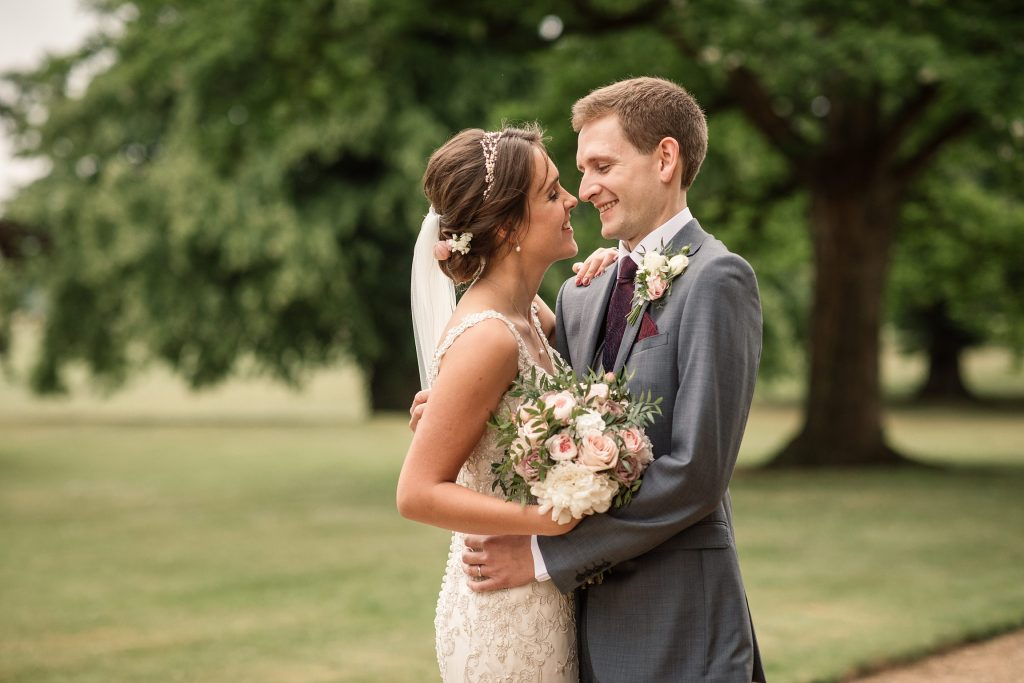 Bride and groom embracing at Shuttleworth Collection Wedding, taken by Becky Harley Photography