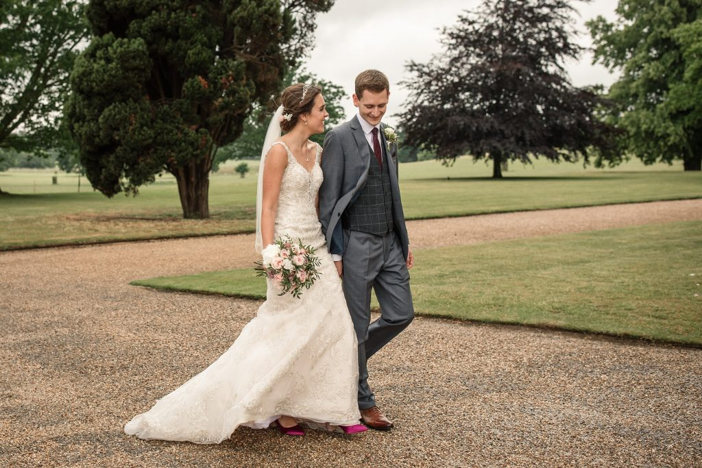 Bride and groom walking at Shuttleworth Collection Wedding, taken by Becky Harley Photography