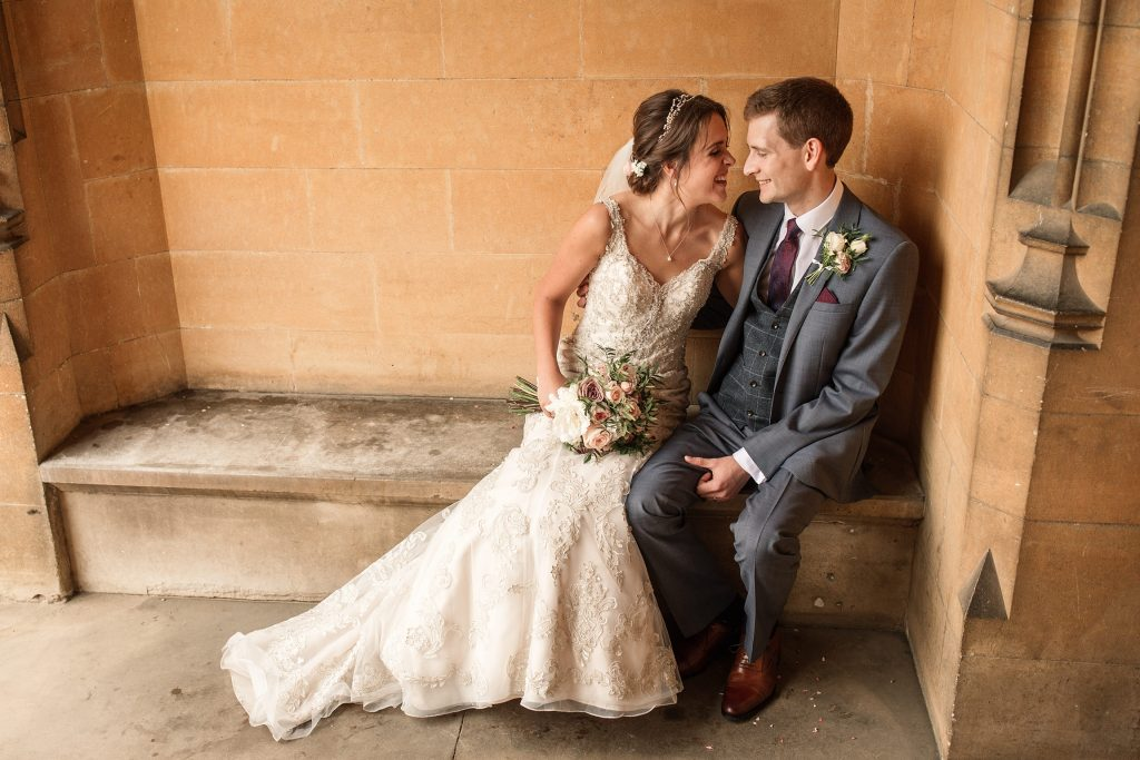 bride and groom seated at Shuttleworth Collection Wedding, taken by Becky Harley Photography