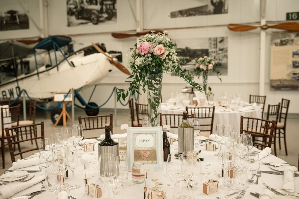 Tables set up in Hangar 3 at Shuttleworth Collection Wedding, taken by Becky Harley Photography